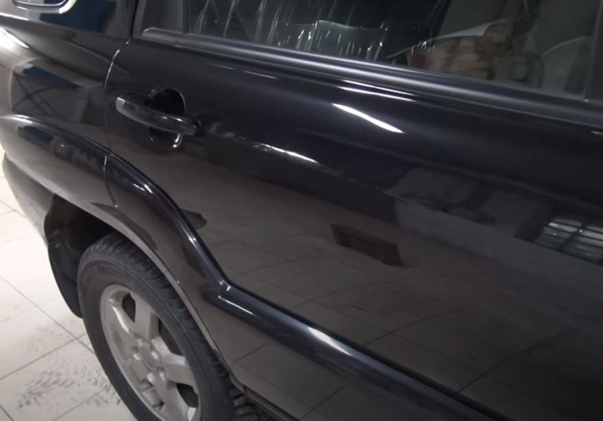 Фото результата ремонта вмятины на двери